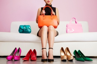 52756089 - colorful shoes and bags with woman sitting on the sofa.